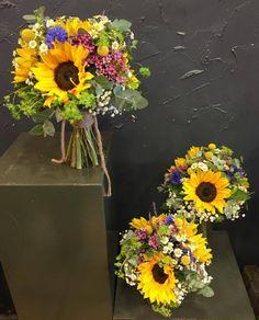 Lovely Bridal bouquet with large-headed sunflowers, corn flowers, eucalyptus, vax flowers, mini daisies, hypericum berries, bluporum, gypsophila, craspidia,