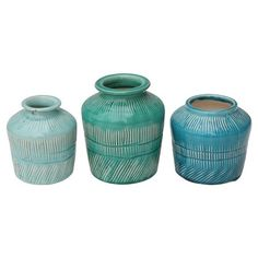 """Stoneware Vases set of 3 (5-7/8""""H)  $28.80 was 31.99, save 10%....  These colorful little beauties are looking for a good home. The Stoneware Vases Set of 3 would be a welcomed addition to any space. Place a few buds in them or leave them solo—their stylish good looks will shine through. Perch them atop your mantel, bookshelf, or coffee table for a chic display.      Number of Pieces: 3      Includes: 2 small vases      Material: Ceramic      Care and Cleaning: Wipe Clean with a Dry Cloth"""