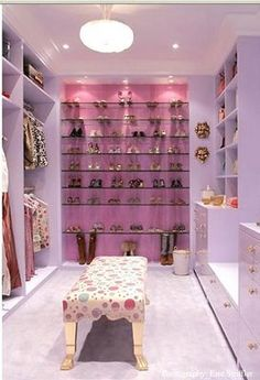 Perfectly posh dressing room in pink.  Fun glass shelves with overhead lighting as in a boutique.