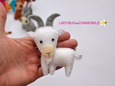 Cute white felt goat ornament.