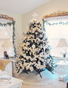 Beautiful tree decorated in white ~ tied fabric garland