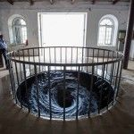A Perpetual Whirlpool of Black Water Installed in a Gallery Floor by Anish Kapoor