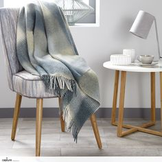 This modern soft blue and green throw has been photographed within the Scandinavian style house, keeping the look on trend for 2017. Clean lines in the oak legs mixed with simple crisp ceramic forms. Lifestyle photography by http://capture.setvisions.co.uk/Portfolio