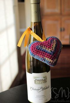 Warm Heart Crochet for Wine Bottle - Red Heart (This beautiful example came from SimplyNotable.com)