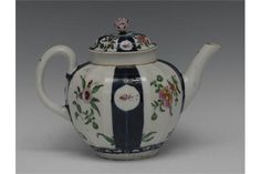 LOT 260  A Worcester Queens pattern fluted teapot, decorated with alternating cobalt blue and white panels of mons and scrolling flowerheads, domed cover, flower finial, 16.5cm high, fret mark, c.1770
