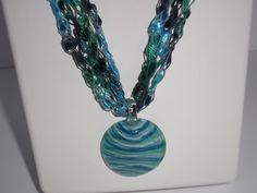 Crochet Ladder Lace Necklace Trellis Ribbon Lace Fiber Yarn Blue Green Dark Grey with Round Pendant by DelsYarnBasket on Etsy