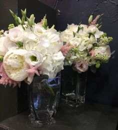 Stunning bridesmaid bouquets with white peonies, white lysianthus, white hydrangea, soft pink astilbe flowers.