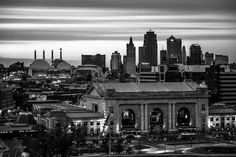 This captivating image of the downtown Kansas City skyline featuring the Union Station, Bartle Hall Convention Center, Kansas City Power and