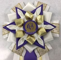 View our collection of ribbons and rosettes available in accents including floral, patterned, glittery golds, silvers and more. Ribbon Rosettes, Centaur, Eggshell, Homecoming, Photo Galleries, Gift Wrapping, Joy, Magic, Purple