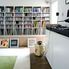 Record collection storage found at http://www.housetohome.co.uk/room-idea/picture/storage-solutions-that-help-you-organise-your-home#