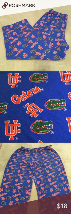"""Vintage UF Gator lounge pants GUC Concepts Sport 100% cotton """"tee shirt"""" fabric blue University of Florida lounge pants from early 2000s. Fabric pattern is comprised of orange, blue, green, and white Gator head logos along with orange and white """"Gators"""" and """"UF"""" written around them. No pockets or fly. Pajama style elastic waist with tie. All items come from a smoke free home. Measurements available upon request. All questions are welcome. Concepts Sport Pants"""