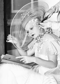 Jean Harlow getting her hair curled on the set of Bombshell (1933)