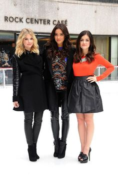 pretty little liars pll style stylish fashion skirt leather black jacket coat pumps boots heels orange blue print sweater cardigan blouse top necklace statement blonde brunette brown hair curls curly hair friends