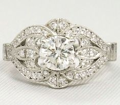This is my dream engagement ring. Guess Darla will have to get a job. Round Diamond Vintage Engagement ring 0.44 TCW in 14K White Gold