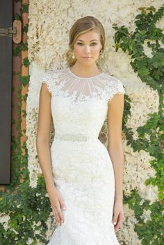 Modest cap sleeve lace mermaid gown.  This lace gown blends the vintage look of an English garden party with modern, slim tailoring. The result is both flattering and timeless.