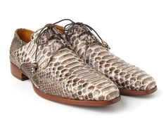 - Natural color genuine python (snakeskin) upper - Ghillie lacing men's dress shoes. - Antique burnished leather sole - Camel leather lining and bordeaux innersole. This is a made-to-order product. Please allow 15 days for the delivery. Because our shoes are hand-painted and couture-level creations, each shoe will have a unique hue and polish, and color may differ slightly from the picture.