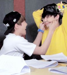 J-Hope is just having fun tugging on Jimin's baby face haha
