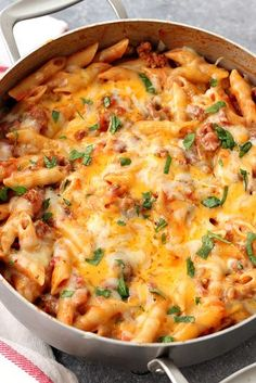 Hearty and satisfying one pan pasta dinner. Italian sausage, quick tomato sauce and penne pasta with cheesy topping is perfect for busy weeknights.