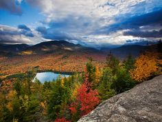 Sunlight dapples the shoulders of Autumn Landscape, Adirondacks. Algonquin and Wright, two of the more than 40 so-called High Peaks that rise above 4,000 feet.