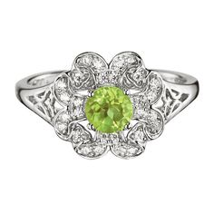 August's birthstone is for everyone! Whether you're an August birthday or a lover of peridots, shop this beautiful sterling silver ring.FEATURES• 3/4 carats• Peridot is 5mm• CZs measure 1mm • 2.74 grams (silver weight is 2.58g)MATERIALS• Sterling silver•Rhodium plating (to prevent tarnish)•Genuine Peridot•CZsCARE• Use sterling silver cleanerMade in China