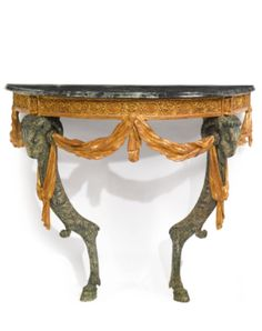 A German Neoclassical parcel-gilt, green-painted and carved console table, based on a design by François Cuvilliés the younger and probably carved by Michael Pössenbacher Munich, circa 1772 - Sotheby's