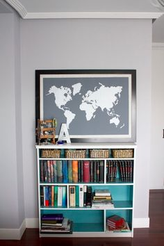 I want this map to mark where I've been. Also love the painted bookshelf.