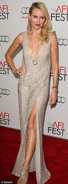 Sensational: Naomi put on a stunning display in a plunging cream sequined gown slit to the thigh at