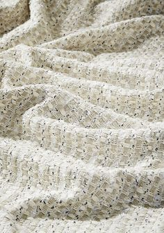 Siam is an intricate weave of linen tapes and ribbons with enough sparkle to create an opulent feminine tweed. This interior fabric is available in 3 colours. Perfect for curtains, soft furnishing and occasional furniture upholstery.