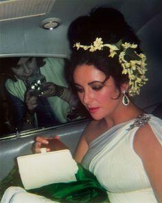Elizabeth Taylor's flower headdress, with diamond and emerald earrings