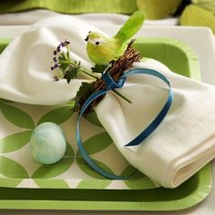 A little over the top, but the cloth napkins with a pretty spring paper plate is nice. Instead of the grapevine wreath with the bird, you could use a pretty ribbon with a small wooden cross.