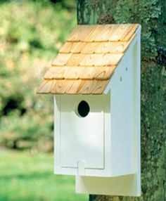 "Country Bluebird House - A cozy love nest. Front panel opens for easy cleaning. Should be placed 4 1/2"" off ground to attract bluebirds. It is crafted in solid cellular vinyl and painted white. 7"" W, 15"" H."