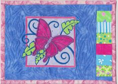 A mug rug embroidered with a tropical butterfly applique machine embroidery design.