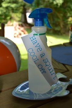 """Backyard Birthday Beach Bash - """"Have a squirt, cool off"""" water bottles on the tables"""