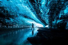 This ice cave was formed during winter months only and had many visitors to see its stunning bluish hues inside.