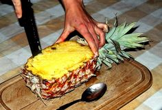 How to Make a Fresh Pineapple Boat for Food Presentation: Cut Around the Inside of the Pineapple.