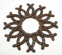 "Great for decorating your front door year round. Weave fabric thru to match the season. Cast iron. 13""Wx13""Hx0.5""D"