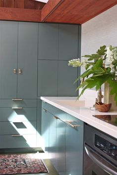 Midcentury Kitchen by cocoon home design - Cabinet paint: Caldwell Green, Benjamin Moore