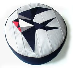 SWALLOW POUFFE Beautiful geometric pouffe with origami inspired patchwork design of a swallow with a red throat on a soft grey background. Scatter Cushions, Cushions On Sofa, Pillows, Bean Bag Liner, Origami Swallow, Leather Footstool, Design Textile, Patchwork Designs, Fabric Manipulation