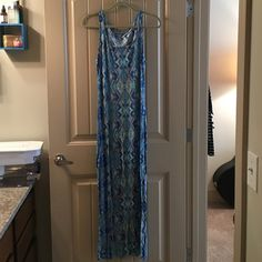 Calvin Klein maxi dress multi colored pattern Calvin Klein maxi dress patterned/blue multicolored. Super soft and stretchy material. Loose fit. Looks great with a tiny braided belt. Size small. 92% viscose, 8% elastane. Calvin Klein Dresses Maxi