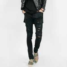Ripped front coated jeans. These skinny jeans sport a flattering low rise with a button and zipper fly closure. The five pocket styling is traditional while the ripped front accents and distressed look of these jeans give them street cred. Pair these jeans with high top sneakers or printed slip ons for a cool weekend look.