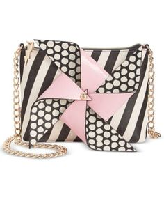 Indulge your fashion fantasy with this freewheeling crossbody bag from Betsey Johnson. Hung from a shiny chain-link strap, it's perfect for going out in fabulous style, day or night. | Faux leather |