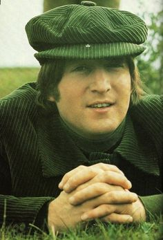 ♡♥John Lennon relaxes outside - click on pic to see a larger pic♥♡