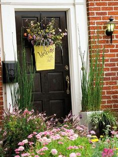 Make your home more welcoming to visitors (and potential buyers!) with these tips.  Enhance your house with touches that improve curb appeal while making visitors feel welcome. Here, the hanging container says it all. Flowers along the walk and in the container finish the look. Read on for more ways to up your home's curb appeal.
