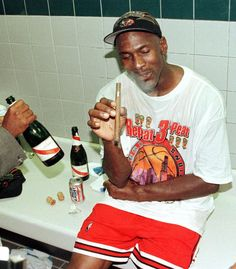 Michael Jordan celebrating after winning the NBA finals two years in a row, 1998