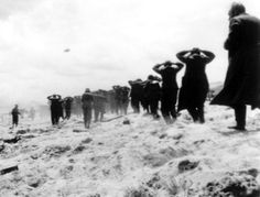 German prisoners of war are led away by Allied forces from Utah Beach, on June 6, 1944