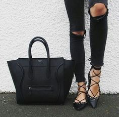 Black jeans, lace-up flats, and a Céline bag.