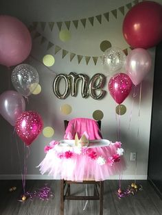 Pink themed high chair decoration for a one year old party