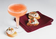 Ingredients        1 cup fresh blood orange juice      1 cup Cointreau or other orange liqueur      1 750-ml bottle chilled Champagne or sparkling wine
