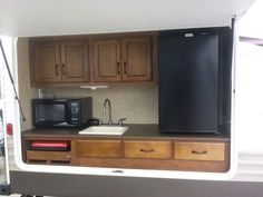 Outdoor kitchen on pull up trailer