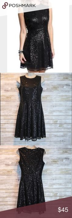 Like New Cynthia Rowley black sequin dress sz 2 Cynthia Rowley black sequin dress w/ sheer panel in front.   Sz 2  Like New Condition Cynthia Rowley Dresses